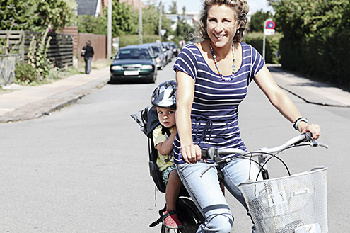 woman-and-toddler-bike-riding-on-a-street-living-life-with-a-stoma